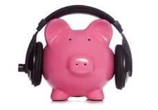 Piggy bank wearing headphones Stock Photography