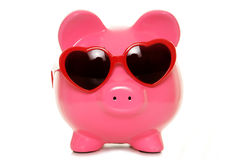 Piggy bank wearing heart shape glasses Stock Images