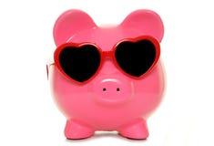Piggy bank wearing heart shape glasses Stock Images