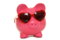 Piggy bank wearing heart shape glasses Royalty Free Stock Images