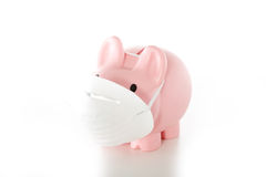 Piggy bank wearing mask Royalty Free Stock Image