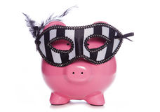 Piggy bank wearing a masquerade mask Stock Photo