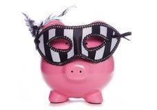 Piggy bank wearing a masquerade mask Stock Photo