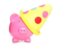 Piggy bank wearing party hat Stock Photos