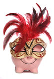 Piggy bank wearing party masquerade mask stock image