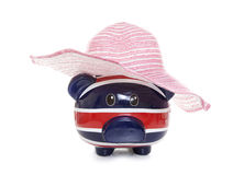 Piggy bank wearing a pink summer hat Royalty Free Stock Photos