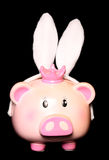 Piggy bank wearing rabbit ears Royalty Free Stock Photos