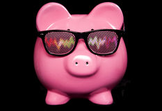 Piggy bank wearing raving glasses Stock Photo