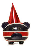 Piggy bank wearing red party hat Stock Photography