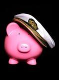 Piggy bank wearing sailors hat Stock Photo