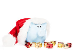 Piggy bank wearing santas hat Royalty Free Stock Photography