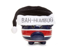 Piggy bank wearing a scrouge bah humbug hat Stock Photo
