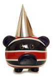 Piggy bank wearing silver party hat. Cutout stock image