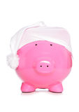 Piggy bank wearing sleeping cap Royalty Free Stock Image