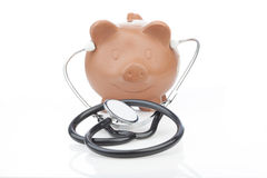 Piggy bank wearing a stethoscope. In a conceptual image of the cost of healthcare and the need for financial planning and savings to cover necessary procedures stock images