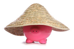 Piggy bank wearing straw hat Stock Photo
