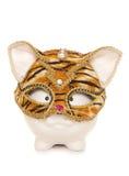 Piggy bank wearing tiger masquerade mask Stock Images