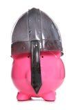 Piggy bank wearing a viking helmet Stock Photo