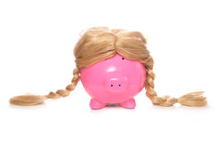 Piggy bank wearing a wig Royalty Free Stock Photos