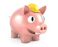 Piggy bank wears small yellow helmet Royalty Free Stock Photo