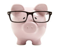 Piggy Bank With Glasses Royalty Free Stock Images