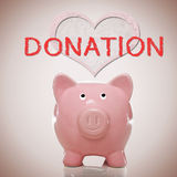 Piggy Bank With Heart And Donation Text Stock Images