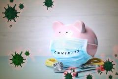 Piggy Bank With Medical Mask. Money Saving During Coronavirus Royalty Free Stock Photo