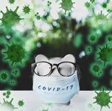 Piggy Bank With Medical Mask. Money Saving During Coronavirus Stock Image