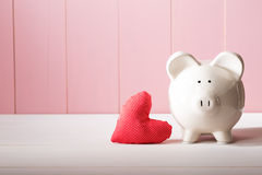 Piggy Bank With Red Heart Pillow Royalty Free Stock Photo