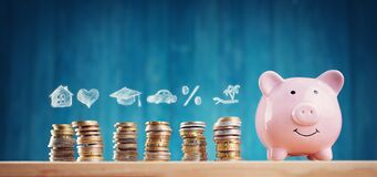 Free Piggy Bank With Stacked Coins On Blue Background Stock Photos - 173244503