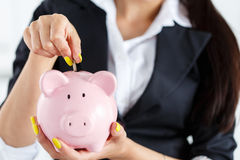 Piggy bank and woman Royalty Free Stock Photo