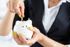Piggy bank and woman Stock Photography