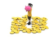 Piggy bank and woman with gold coins Stock Images