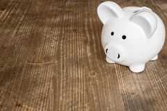 Piggy bank on wood table Stock Image