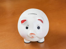 Piggy Bank on wood table Stock Photography