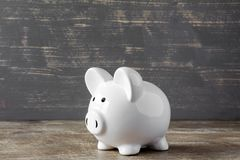 Piggy bank on wooden background Royalty Free Stock Photo