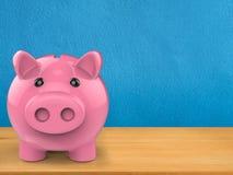 Piggy bank on wooden counter. 3d rendering piggy bank on wooden counter Royalty Free Stock Image
