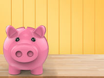 Piggy bank on wooden counter Stock Photos