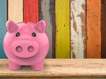 Piggy bank on wooden counter Stock Photo