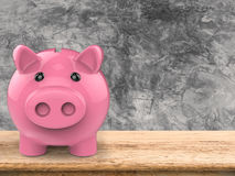 Piggy bank on wooden counter Royalty Free Stock Photos