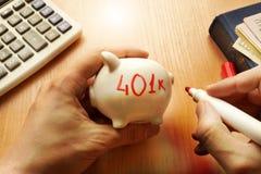 Piggy bank with word 401k. Retirement plan. Piggy bank with word 401k. Retirement plan concept royalty free stock image