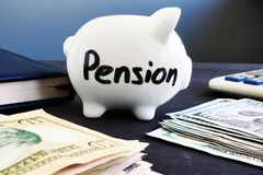 Piggy bank with  pension and money. Retirement planning. Royalty Free Stock Image