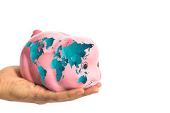 Piggy bank with worldmap in male hand isolated on white Royalty Free Stock Image