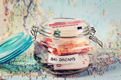 Piggy bank woth words Big Dreams on travel map. Saving money for travel. Dreaming Concept Royalty Free Stock Photography