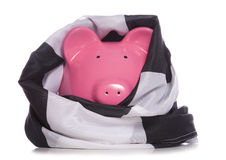 Piggy bank wrapped in checkered flag Royalty Free Stock Photos