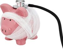 Piggy bank wrapped in gauze with a stethoscope -. Stethoscope bank piggy piggy bank white background money Stock Photo