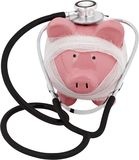 Piggy bank wrapped in gauze with a stethoscope -. Stethoscope bank piggy piggy bank white background money stock photography