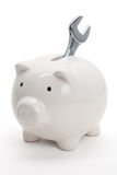 Piggy Bank and Wrench Royalty Free Stock Photos
