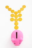 Piggy bank and yen sign. Pink piggy bank and yen sign made from gold coins over white background Royalty Free Stock Photo