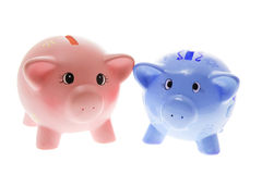 Piggy Banks. Two Piggy Banks on White Background Royalty Free Stock Photography